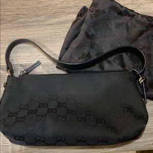 Black Gucci makeup bag